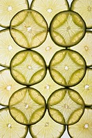 Lime slices arranged in design on white background