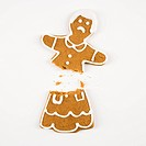 Frowning female gingerbread cookie broken in half