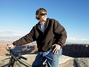Young man with mountain bike (thumbnail)