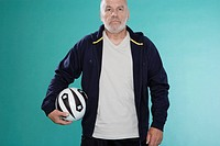 Senior man with soccer ball