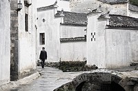 Man walking in the street, Xi Di Xidi village, UNESCO World Heritage Site, Anhui Province, China, Asia