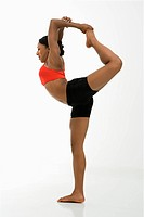 Profile of African American woman in Lord of the Dance Yoga position.