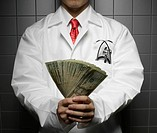 Doctor Holding US Dollars (thumbnail)