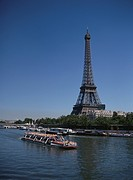 The Eiffel Tower And A Boat In Paris, France