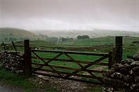 Farm gate and overcast skies near Malham, Yorkshire Dales National Park, Yorkshire, England, United Kingdom, Europe
