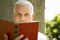 Senior caucasian reading a book, Front View, Differential Focus