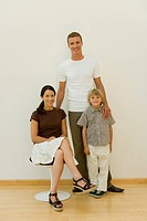 Caucasian family smiling at camera, Front View