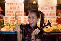 Asian woman Chinese_Thai, Dong´anmen food market, Wanfungjing, Beijing, China, Asia