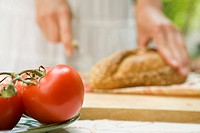 Hands cutting bread and tomatos, Close Up, Differential Focus