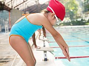 Girl at starting block for swimming race