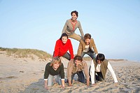 Five people forming human pyramid portrait