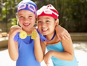 Girls in swimming costumes holding medals portrait