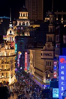Elevated view along Nanjing Donglu Road illuminated with neon signs at night, Shanghai, China, Asia