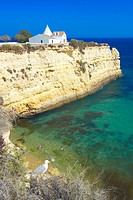 Church on cliff by beach, Algarve, Portugal, Europe