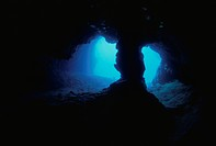 An Underwater Cave With A Pillar