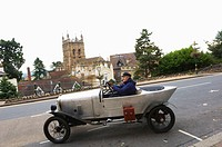 Amilcar is seen against the backdrop of The Priory Malvern Worcestershire
