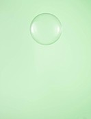 Single Water Droplet on Green Background