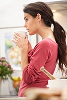 A young woman drinking coffee
