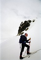Side view of man walking on snowcapped land Fjälltur i södra Sarek.