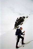 Side view of man walking on snowcapped land Fjälltur i södra Sarek.