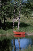 A Red Boat Reflecting On A Lake In Germany (thumbnail)