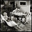 Mother having food in lawn with two children b/w 0607b 020
