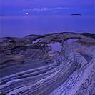 Kustlandskap Med Ådrade Berghällar Ner Mot Vattnet Och Fullmåne Vid Horisonten, Småland, Rocks By Sea At Dusk