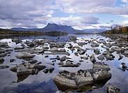 Rock in sea against sky Sjön Laitaure och fjället Tjakkeli, på gränsen mot Sarek, Lappland.