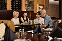 Friends sitting at restaurant table