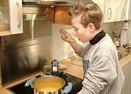 Boy cooks