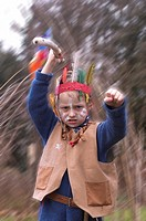 Dressed up boy plays playing Indian Native American