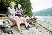 Couple sitting on log