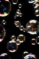 Bubbles. Different size bubbles, showing colourful patterns in their surface film.