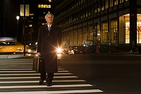 Businessman crossing the street
