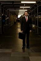 Businessman standing on a walkway