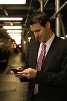 Businessman text messaging