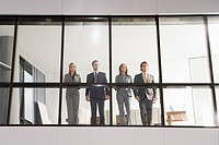 Businesspeople in office window