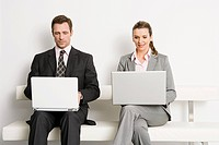 Businesspeople with laptops