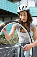 Woman with bike wheel (thumbnail)