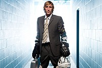 Businessman with an ice hockey uniform