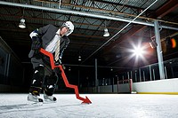 Businessman playing ice hockey