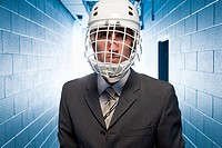 Businessman in an ice hokcey helmet