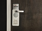 Do not disturb sign on a hotel room door (thumbnail)