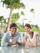 Smiling couple at breakfast (thumbnail)