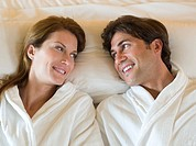 Smiling couple lying in bed (thumbnail)