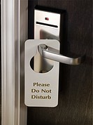 Do not disturb sign on a hotel room door