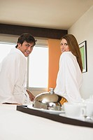 Smiling couple in a hotel room