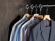 Shirts and suits in a closet