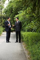 Chinese businessmen in a park