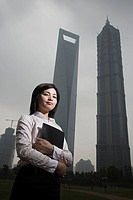Chinese businesswoman near skyscrapers
